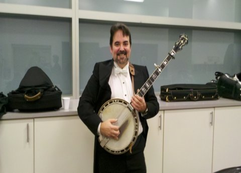 Eric playing formal banjo, Omaha Symphony